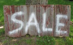 The previous renters left this spray painted SALE sign, which ended up being the star of my Craig's List ads for for the stuff we needed to clear out.