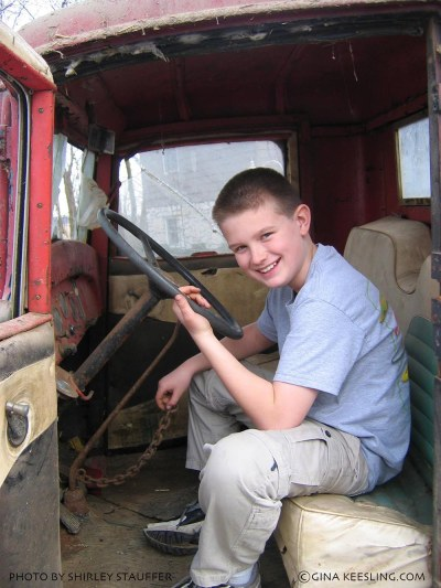 A young Jordan Keesling checking out his grandpa's old Chevy truck that's been parked in the barn for years. Why is there a piece of CHAIN welded to the gearshift? Apparently that's what Dad padlocked his toolbox to - so it wouldn't be stolen. Rob Keesling restored this truck with help from Jordan - and left the chain in place as a memento of security systems from days gone by.